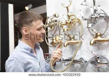 Man shopping for bathroom equipment in hardware store, shop for construction