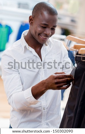 Man shopping for clothes at a retail store