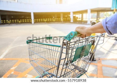 Man shopping in supermarket with shopping carts.