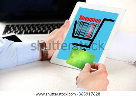 Man shopping online with digital tablet