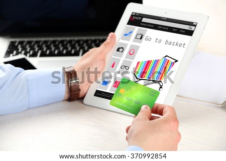 Man shopping online with digital tablet - stock photo