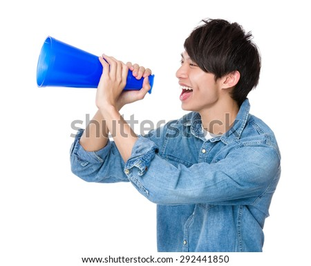 Man shout with megaphone - stock photo