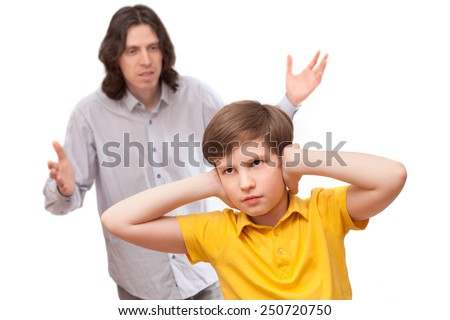 Man shouting at a small boy who is not listening, isolated on white background  - stock photo