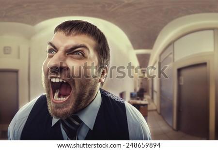 Man shouting at office - stock photo