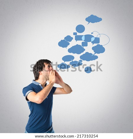 Man shouting over grey background
