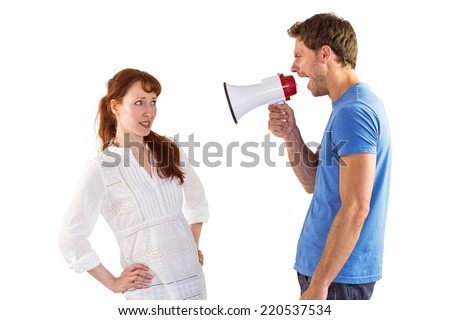 Man shouting through a megaphone at woman on white background - stock photo
