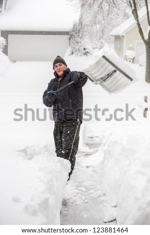 Man shoveling snow - stock photo