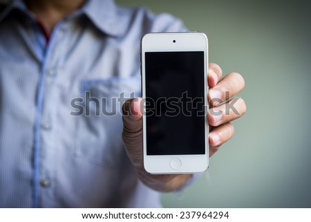 man show his smart phone, smart phone in the hand - stock photo