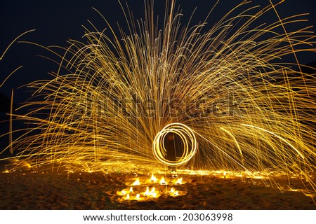 Man show swing fire - stock photo