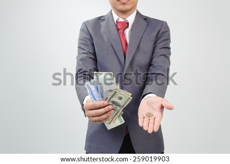 Man showing bank note compare with coin