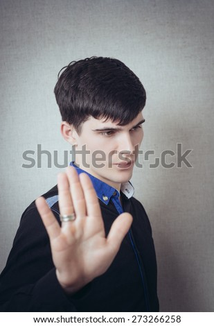 Man showing gesture stop. On a gray background. - stock photo