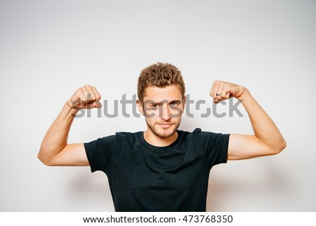 man showing her muscles