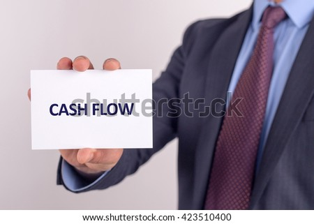 Man showing paper with CASH FLOW text