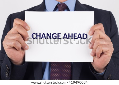 Man showing paper with CHANGE AHEAD text - stock photo