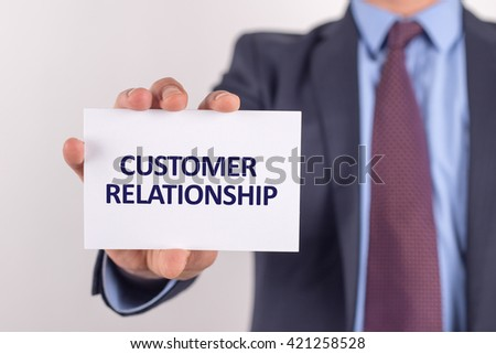 Man showing paper with CUSTOMER RELATIONSHIP text - stock photo