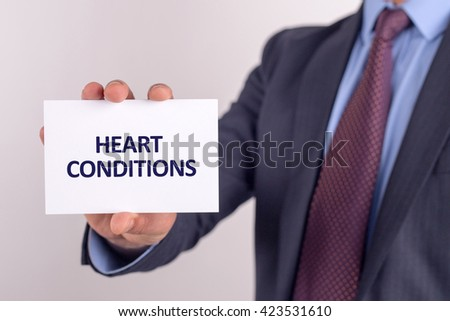 Man showing paper with HEART CONDITIONS text