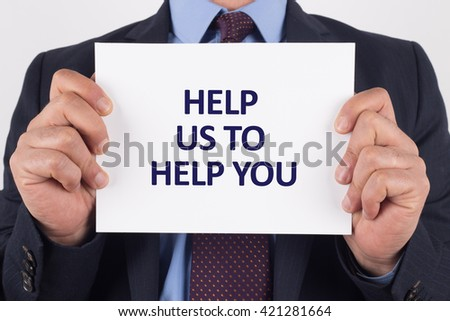 Man showing paper with HELP US TO HELP YOU text - stock photo