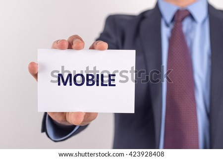 Man showing paper with MOBILE text