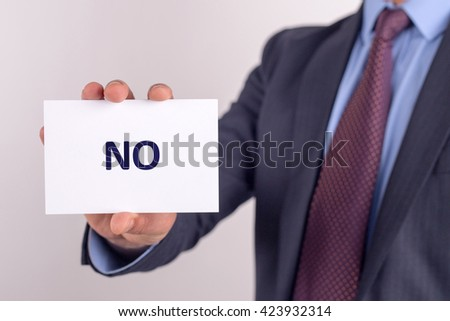 Man showing paper with NO text - stock photo