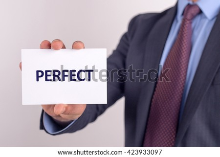 Man showing paper with PERFECT text