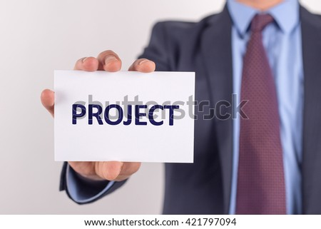 Man showing paper with PROJECT text