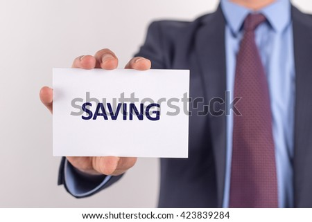 Man showing paper with SAVING text