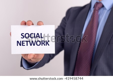 Man showing paper with SOCIAL NETWORK text