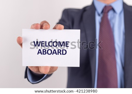 Man showing paper with WELCOME ABOARD text