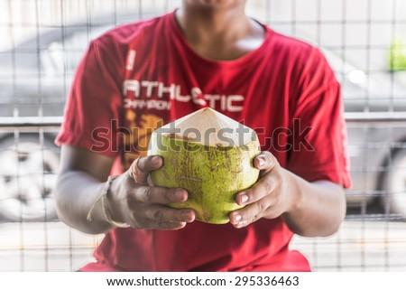 Man showing peeled coconut