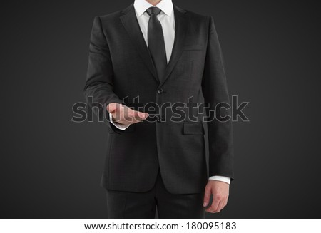 man showing something on a white background