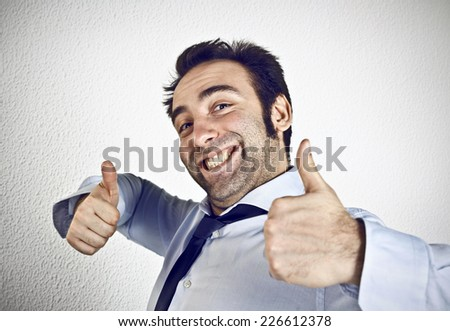 Man showing thumb up gesture - stock photo