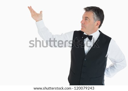 Man showing us something in the air with his hand