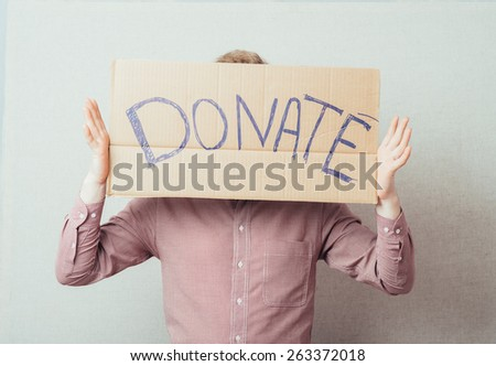 man shows a poster donate