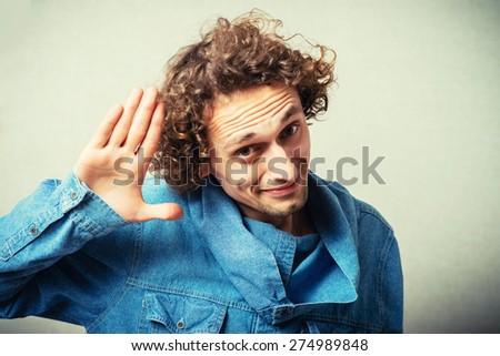 man shows hi - stock photo