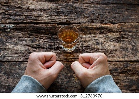man shows willpower not to drink alcohol - stock photo
