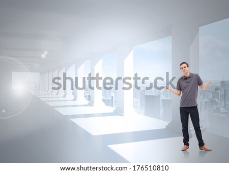 Man shrugging his shoulders against bright white room with windows - stock photo