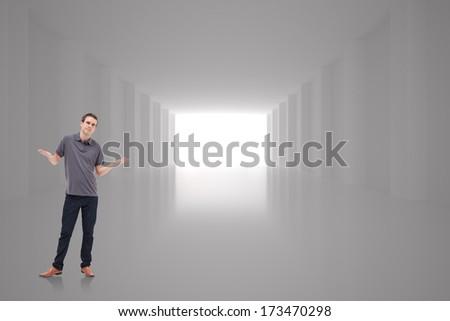 Man shrugging his shoulders against digitally generated room - stock photo