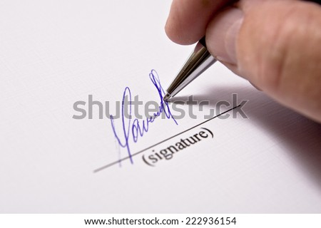 Man signing papers. The signature. - stock photo