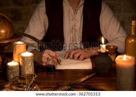 man signs a document, medieval theme