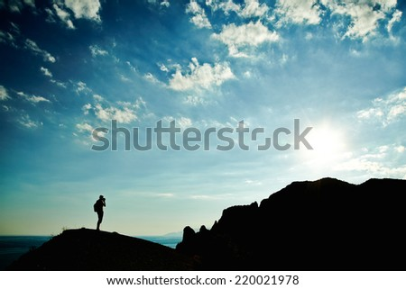 Man silhouette at sunset in mountains. Crimea landscape - stock photo