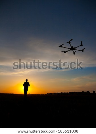 Man silhouette with rc plane (focus on RC model) - stock photo