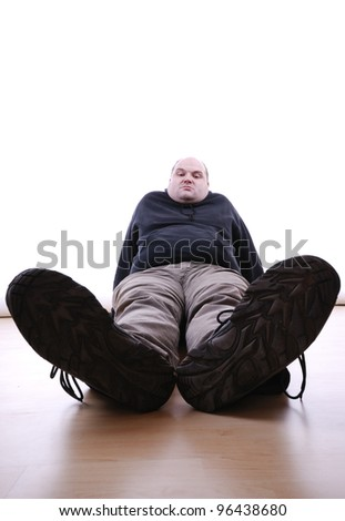 man sits lazy on the floor - stock photo