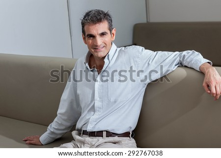Man sitting and looking at camera