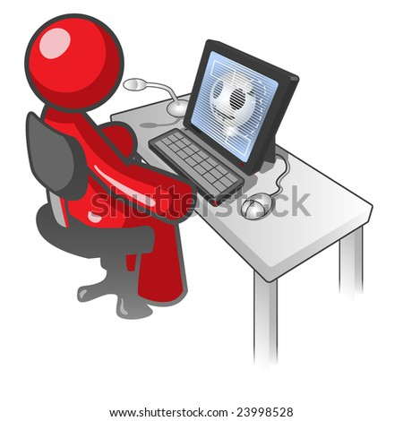 man sitting at a computer desk monitoring an X ray or something random.  Also has a mouse and microphone.