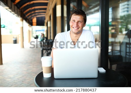 man sitting at cafe and drinking coffee