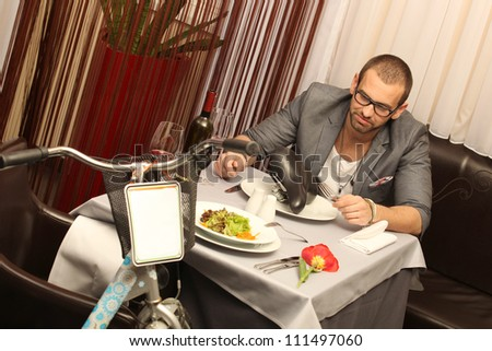 man sitting at table - stock photo