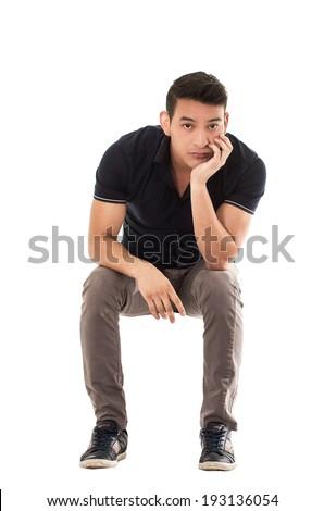 man sitting bored waiting on white background - stock photo