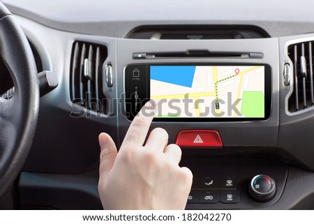 man sitting in a car and touch play finger in a navigation map