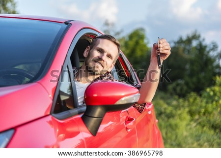 Man Sitting In A Car Outdoors and Showing New Keys. Concept of travel, rent or buying car.  - stock photo