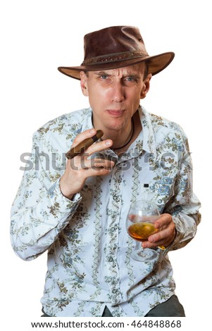 Man sitting in a cowboy hat with a glass isolated on white background